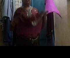 Bhabi veldt Brassiere n Pink Panty Captured while Changing Dress